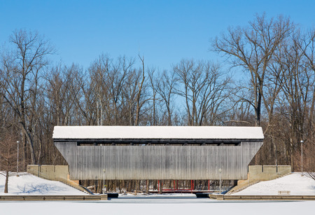 The New Brownsville Covered Bridge, seen here blanketed in winter snow, was built in 1840, was relocated to Columbus, Indiana in 1986.