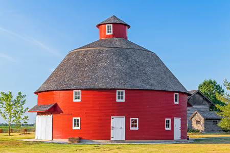 A red round barn stands on Indiana farmland. photo