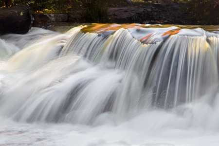 whitewater: Whitewater, photographed with a long exposure, splashes over boulders at Upper Peninsula Michigan