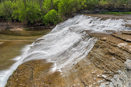 Thistlethwaite falls is a waterfall that cascades down rocky ledges in Richmond, Indiana.