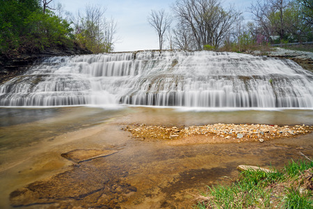 cascading: Thistlethwaite Falls is a cascading waterfall in Richmond, Indiana. Stock Photo