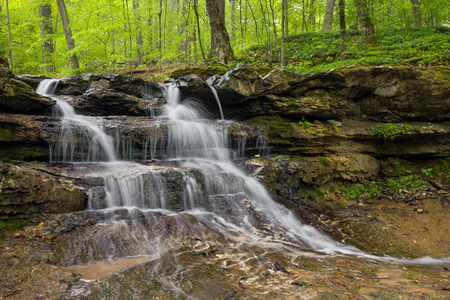 rock strata: A beautiful little waterfall cascades over layers of rock strata near the dam at Indiana