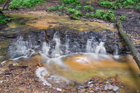 ledge: A stream cascades over a small rock ledge in Shades Start Park Indiana. Stock Photo