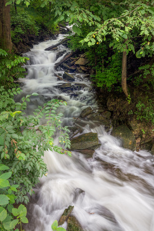 unincorporated: A beautiful cascading waterfall flows along a Warren County, Ohio road in the unincorporated town of Fosters.
