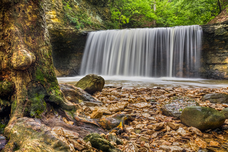 indian creek: A beautiful waterfall plunges over a rock cliff at Indian Run Park in Dublin, Ohio, an area once home to the Wyandotte Tribe. Stock Photo