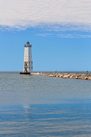 The Frankfort North Breakwater Lighthouse marks the harbor of this historic town on Michigans Lake Michigan Coast.