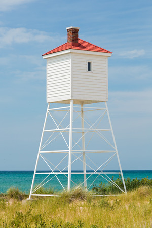 ludington: The fog horn tower at Michigans Big Sable Point Lighthouse stands over Lake Michigan on a sunny summer day.