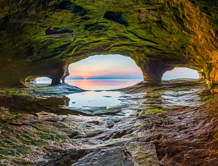 alger: The sun sets on Lake Superior as photographed from a sea cave on the north Michigan coast.