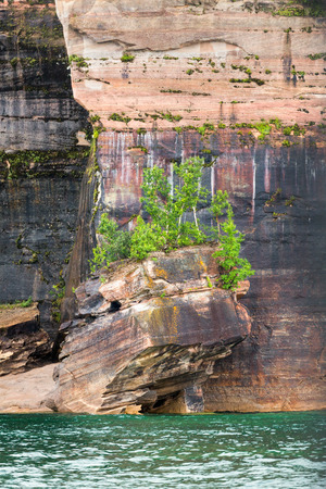 upper peninsula: Colorful cliffs tower above Lake Superior on the Upper Peninsula Michigan coast at Pictured Rocks National Lakeshore. Stock Photo