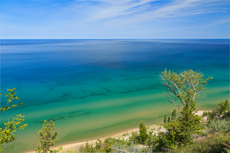 Lake Michigan is viewed from high atop a sand dune bluff midway between Frankfort and Manistee, Michigan.