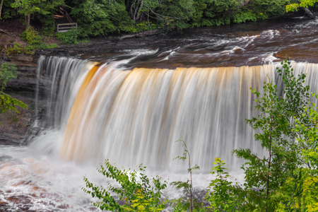 cataract falls: Upper Peninsula Michigans Upper Tahquamenon Falls is the second largest waterfall in the United States east of the Mississippi River. Stock Photo