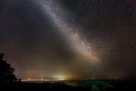 milky way galaxy: The Milky Way Galaxy shines above the Mackinac Bridge on a clear night in Michigan.