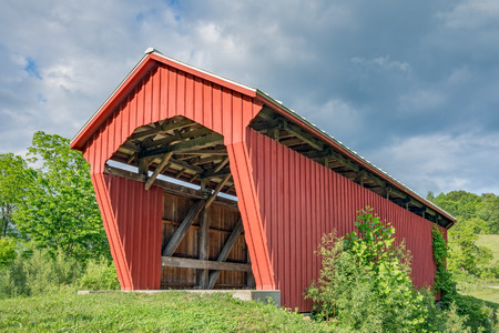 Manchester Covered Bridge, built in 1915, crosses Olive Green Creek in rural Noble County, Ohio.