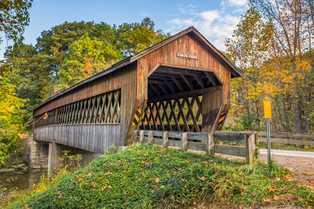 covered bridge: State Road Covered Bridge, built in 1983, crosses Conneaut Creek in rural Ashtabula County, Ohio in autumn.