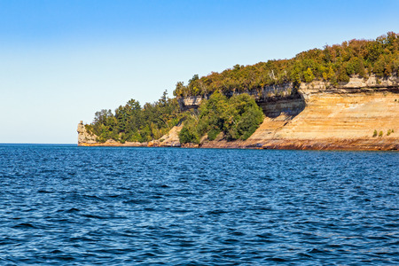 mineros: The colorful cliffs of Michigans Pictured Rocks National Lakeshore look down on Lake Superior at Miners Castle.