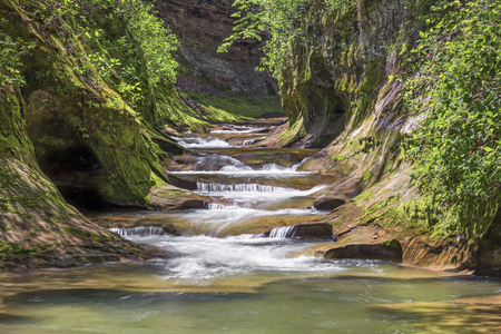 warren: Water cascades down The Potholes at Fall Creek Gorge Preserve in Warren County, Indiana.
