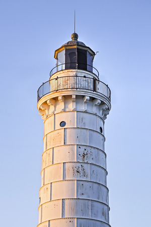 lake michigan lighthouse: Door County, Wisconsins Cana Island Lighthouse glows warm in the light of the rising sun on Lake Michigan.