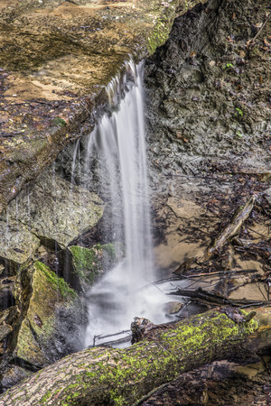 overhang: Whitewater plunges over the small Maidenhair Falls, a waterfall in Shades State Park, Indiana.