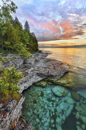 ephemeral: The ephemeral majesty of early morning is captured on the rocky Lake Michigan coastline of Door County, Wisconsins Cave Point.