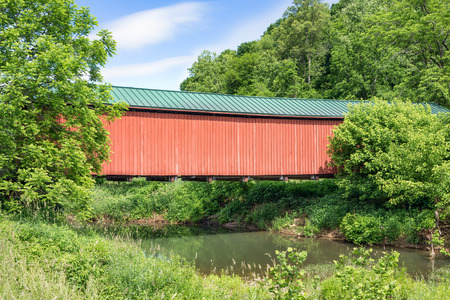 covered bridge: Built in 1886, Ohios red Foraker Covered Bridge crosses the Little Muskingum River in rural Monroe County.