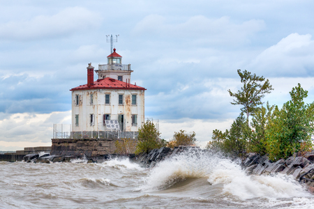 blustery: Ohios Fairport Harbor Lighthouse shines its light on a blustery morning along the Lake Erie coast. Stock Photo
