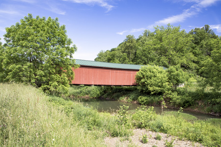 of yesteryear: The historic red Foraker Covered Bridge crosses the Little Muskingum River in Monroe County, Ohio.