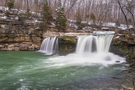 plunging: Water spills over Upper Cataract Falls, a waterfall in Owen County, Indiana, as late winter snow melts into spring.