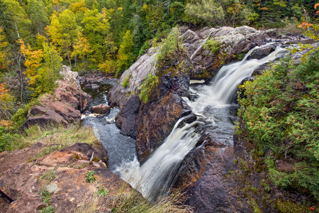 upper peninsula: Upper Peninsula Michigans Black River pours over Gabbro falls, a wild, beautiful waterfall with two tiers.