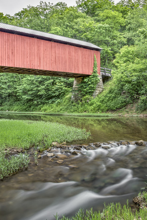 yesteryear: The historic red Hume covered bridge crosses the Little Muskingum River in rural Washington County, Ohio.