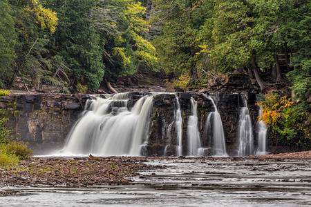 upper peninsula: Manabezho Falls, a beautiful waterfall on the Presque Isle River, spills over a rocky cliff in Porcupine Mountains State Park of Michigans western Upper Peninsula. Stock Photo