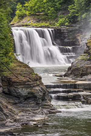 New Yorks Genesee River plunges over the Lower Falls at Letchworth State Park.