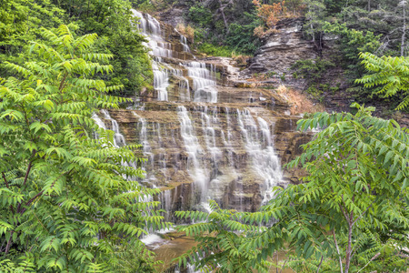 Ribbons of whitewater cascade down Hector Falls, a roadside waterfall in New Yorks Finger Lakes Region. Stock Photo