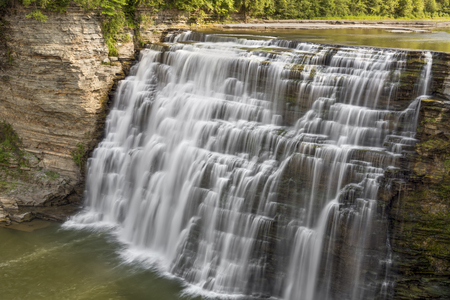 The Genesee River plunges and cascades down the Middle Falls at Letchworth State Park, New York.