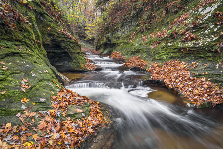 Water cascades down The Potholes, a series of rocky ledges eroded by swirling currents in Fall Creek Gorge, Warren County, Indiana.