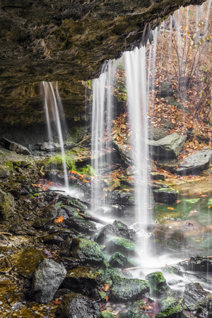 A waterfall at Wheeling, West Virginias Oglebay Park is viewed from behind and below. Stock Photo