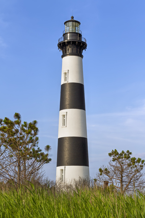 obx: The historic Bodie Island Lighthouse rises over the coastal landscape of Cape Hatteras National Seashore on the Outer Banks of North Carolina. Stock Photo