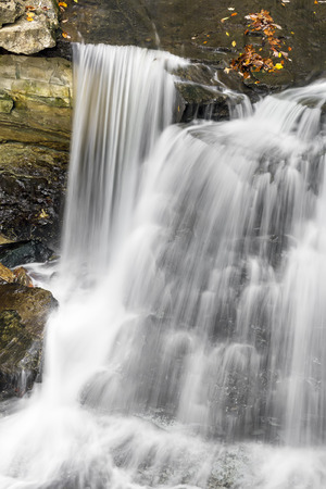 Whitewater plunges and cascades over Indianas McCormicks Creek Falls. Stock Photo