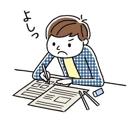 勉強している少年
