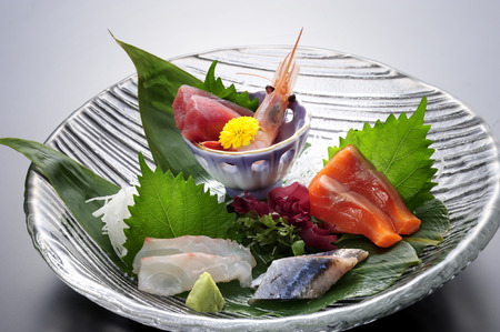 japanese cuisine: Seafood in a black plate