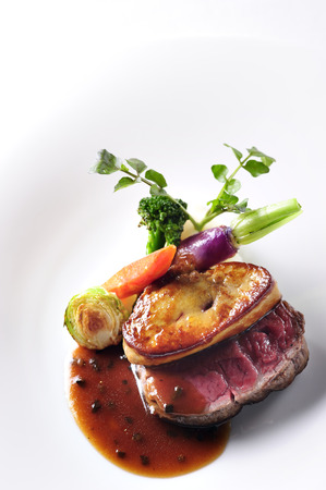 Steak on white dish photo