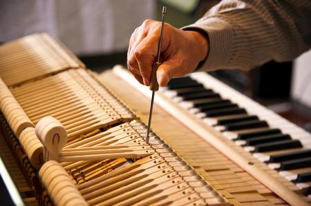 man testing a Piano