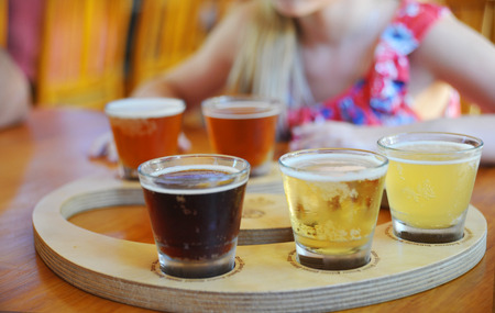 Craft beers are served together in a sampler tray for the beer enthusiast at a restaurant in Perth