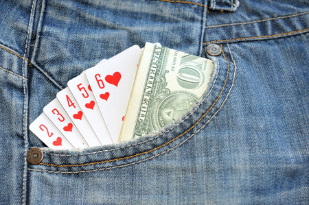 straight flush: Straight Flush playing cards and money in pocket  Jeans Stock Photo