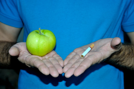 right choice: Make the right choice - apple and cigarette in  hands