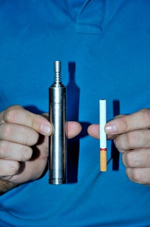 cig: Concept of choosing the type of cigarette in hands vertical