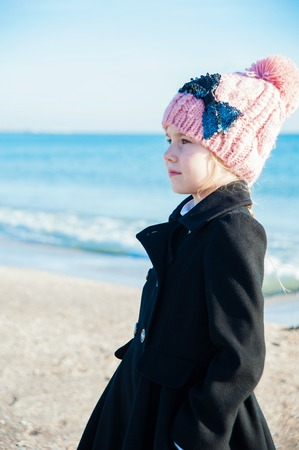 8 years: Portrait of 8 years old girl  near sea in pink hat, still life photo Stock Photo
