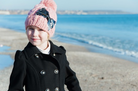 8 years old: Portrait of 8 years old girl  near sea in pink hat, still life photo Stock Photo