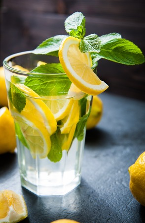 Refreshing cold lemonade, Cocktail on dark stone table Stock Photo