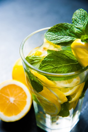 non alcoholic beverage: Glass of lemonade with lemons and fresh mint, dark wooden backround, close up Stock Photo