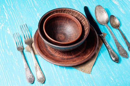Vintage old tableware, cutlery on blue wooden backround